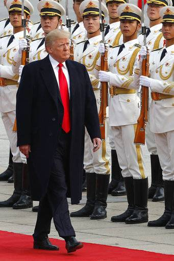 U.S. President Donald Trump reviews an honor guard with Chinese President Xi Jinping during a welcome ceremony at the Great Hall of the people in Beijing, Thursday, Nov. 9, 2017.