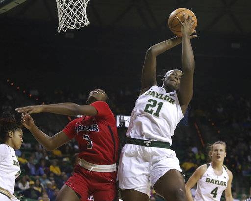 Baylor center Kalani Brown (21) grabs the rebound against Lamar forward Kyla Green (3) during the first half of an NCAA college basketball game, Friday. Nov. 10, 2017, in Waco, Texas. (AP Photo/Jerry Larson)