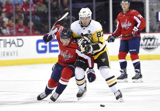 Pittsburgh Penguins center Sidney Crosby (87) chases the puck against Washington Capitals left wing Jakub Vrana (13), of the Czech Republic, during the first period of an NHL hockey game, Friday, Nov. 10, 2017, in Washington.