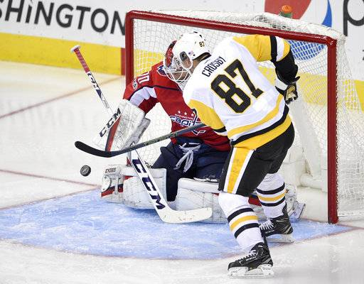 Washington Capitals goalie Braden Holtby (70) stops Pittsburgh Penguins center Sidney Crosby (87) during the third period of an NHL hockey game, Friday, Nov. 10, 2017, in Washington. The Capitals won 4-1.