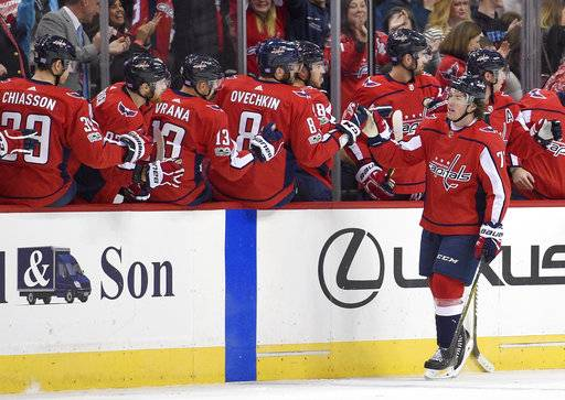 Washington Capitals right wing T.J. Oshie (77) celebrates his goal with Washington Capitals left wing Alex Ovechkin (8), of Russia, and the bench during the second period of an NHL hockey game against the Pittsburgh Penguins, Friday, Nov. 10, 2017, in Washington.