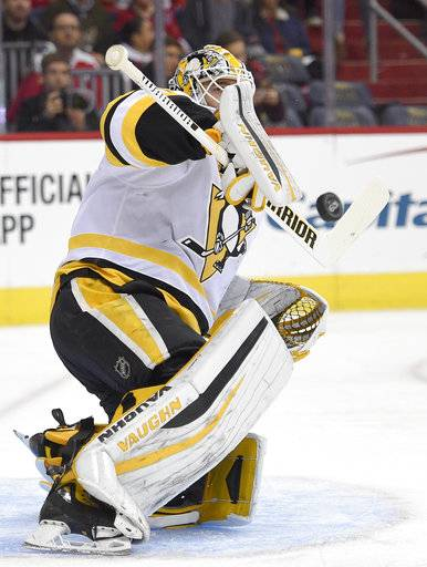 Pittsburgh Penguins goalie Matt Murray (30) stops the puck during the first period of an NHL hockey game against the Washington Capitals, Friday, Nov. 10, 2017, in Washington.