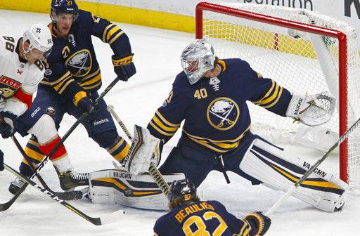 Buffalo Sabres goalie Robin Lehner (40) stops Florida Panthers Jamie McGinn (88) during the second period of an NHL hockey game, Friday Nov. 10, 2017, in Buffalo, N.Y.