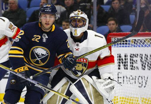 Buffalo Sabres forward Johan Larsson (22) skates in front of Florida Panthers goalie Roberto Luongo (1) during the first period of an NHL hockey game, Friday Nov. 10, 2017, in Buffalo, N.Y.