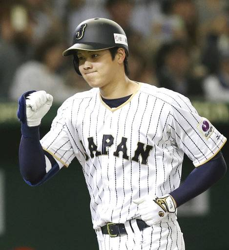 FILE - In this Nov. 12, 2016, file photo, Japan's designated hitter Shohei Otani reacts after hitting a solo home run off Netherlands' starter Jair Jurrjens in the fifth inning of their international exhibition series baseball game at Tokyo Dome in Tokyo. Texas, the New York Yankees and Minnesota can pay the most to an international free agent as highly touted pitcher-outfielder Shohei Otani prepares to enter the market, and Major League Baseball and its Japanese counterpart have agreed to the outlines of a deal to keep the old posting system for this offseason.
