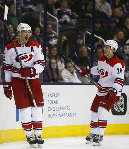 Carolina Hurricanes' Jordan Staal, left, celebrates his goal against the Columbus Blue Jackets with teammate Sebastian Aho, of Finland, during the third period of an NHL hockey game Friday, Nov. 10, 2017, in Columbus, Ohio. The Hurricanes beat the Blue Jackets 3-1.