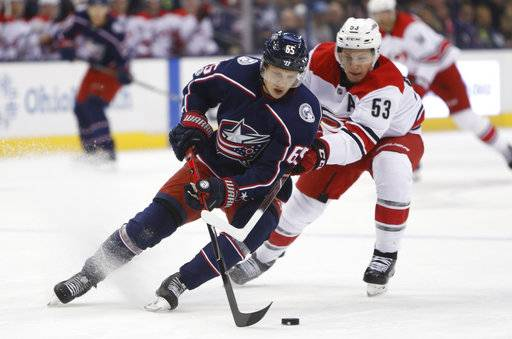 Columbus Blue Jackets' Markus Nutivaara, left, of Finland, tries to clear the puck past Carolina Hurricanes' Jeff Skinner during the first period of an NHL hockey game Friday, Nov. 10, 2017, in Columbus, Ohio.