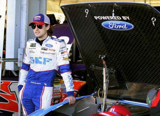 Ryan Blaney stands next to his race car before practice for the NASCAR Cup Series auto race at Phoenix International Raceway, Friday, Nov. 10, 2017, in Avondale, Ariz. Blaney is one of five drivers looking to fill the final spot for the Championship 4.