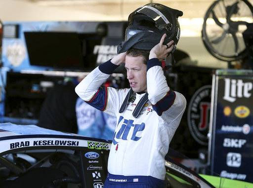 Brad Keselowski puts on his helmet before practice for the NASCAR Cup Series auto race at Phoenix International Raceway, Friday, Nov. 10, 2017, in Avondale, Ariz. Keselowski is one of five drivers looking to fill the final spot for the Championship 4.