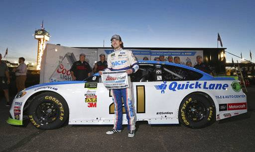 Ryan Blaney holds the pole award after winning the starting position for a NASCAR Cup Series auto race at Phoenix International Raceway, Friday, Nov. 10, 2017, in Avondale, Ariz.