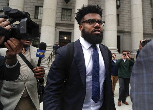 FILE - In this Thursday, Nov. 9, 2017, file photo, Dallas Cowboys NFL football star Ezekiel Elliott walks out of federal court in New York.   Elliott's half-season run from his six-game suspension ended when a federal appeals court refused to let him play while it considers his appeal.