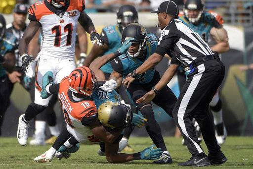 Cincinnati Bengals wide receiver A.J. Green (18) takes down Jacksonville Jaguars cornerback Jalen Ramsey (20) during a fight in the first half of an NFL football game Sunday, Nov. 5, 2017, in Jacksonville, Fla.