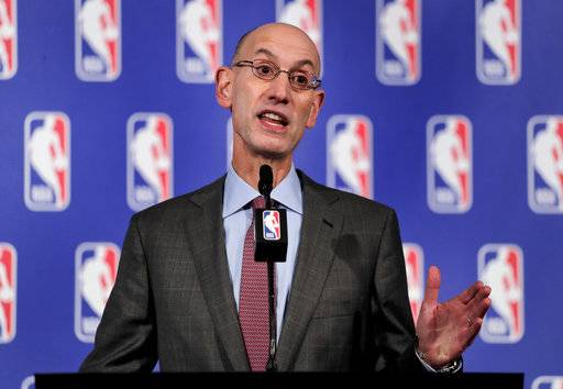 FILE - In this Sept. 28, 2017 file photo, NBA Commissioner Adam Silver speaks during a news conference in New York.   Chicago will host the 2020 All-Star game for the first time since 1988, when Michael Jordan took off from the foul line in an epic dunk contest and delivered an MVP performance in the game.  Silver, Mayor Rahm Emanuel and Bulls executives Michael Reinsdorf and John Paxson were on hand Friday, Nov. 10 for the announcement on the United Center floor.