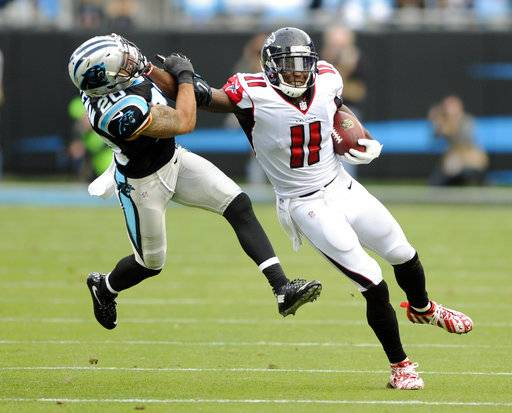 FILE - In this Dec. 24, 2016, file photo, Atlanta Falcons' Julio Jones (11) pushes away Carolina Panthers' Kurt Coleman (20) after a catch in the second half of an NFL football game in Charlotte, N.C. Jones has had a very quiet year by his own standards with only one 100-yard game and one touchdown this season.  But facing the Panthers on Sunday, Nov. 5, 2017, could be the cure to those issues. Jones has 25 receptions for 538 yards and two TDs in his last three meetings with Carolina.