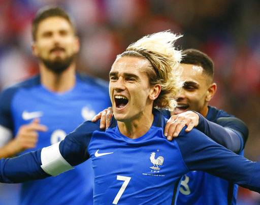 France's Antoine Griezmann celebrates after scoring his side's opening goal during an international friendly soccer match between France and Wales at Stade de France in Saint Denis, a northern suburb of Paris, France, Friday, Nov. 10, 2017.