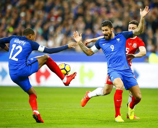 France's Kylian Mbappe, left, controls the ball while his teammate Olivier Giroud reacts during an international friendly soccer match between France and Wales at Stade de France in Saint Denis, a northern suburb of Paris, France, Friday, Nov. 10, 2017.