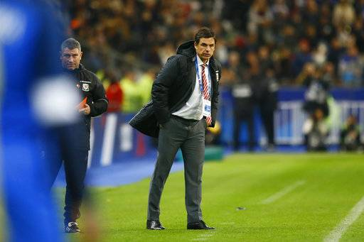 Wales' head coach Chris Coleman watches his players during an international friendly soccer match between France and Wales at Stade de France in Saint Denis, a northern suburb of Paris, France, Friday, Nov. 10, 2017.