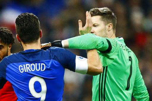 Wales' goalkeeper Wayne Hennessey, right, and France's Olivier Giroud clash during an international friendly soccer match between France and Wales at Stade de France in Saint Denis, a northern suburb of Paris, France, Friday, Nov. 10, 2017.