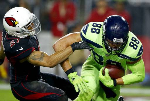 Seattle Seahawks tight end Jimmy Graham (88) catches a touchdown pass as Arizona Cardinals strong safety Tyvon Branch (27) defends during the first half of an NFL football game, Thursday, Nov. 9, 2017, in Glendale, Ariz.