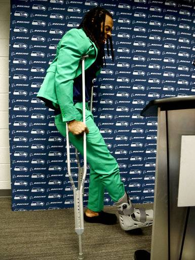 Seattle Seahawks cornerback Richard Sherman arrives on crutches to speak after an NFL football game against the Arizona Cardinals, Thursday, Nov. 9, 2017, in Glendale, Ariz. Sherman ruptured his achilles during the Seahawks 22-16 win.