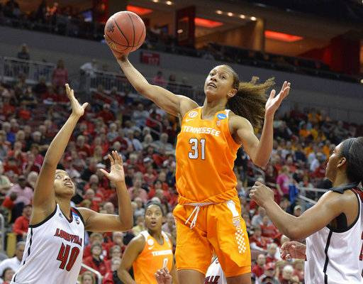 "FILE - In this March 20, 2017, file photo, Tennessee's Jaime Nared (31) grabs a rebound between Louisville's Ciera Johnson (40) and Myisha Hines-Allen (2) during an NCAA women's college basketball tournament game in Louisville, Ky. Nared was caught off guard this year when a teammate called her a ""mother figure,"" but that's a role she's filling as one of the lone seniors on a freshman-laden team."