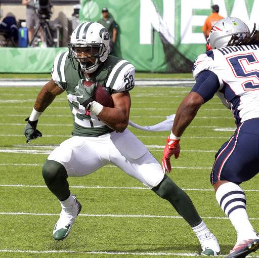 FILE - In this Oct. 15, 2017, file photo, New York Jets running back Matt Forte (22) attempts to get by New England Patriots middle linebacker Dont'a Hightower (54) during the first half of an NFL football game, in East Rutherford, N.J. Forte has been ruled out against the Tampa Bay Buccaneers on Sunday because of swelling in his surgically repaired right knee. (AP Photo/Bill Kostroun, File)
