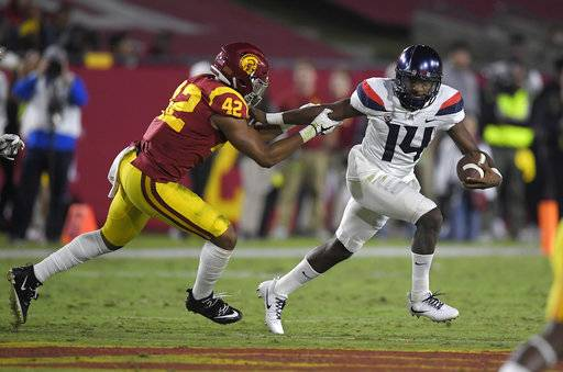 Arizona quarterback Khalil Tate, right, tries to escape a tackle by Southern California linebacker Uchenna Nwosu during the first half of an NCAA college football game, Saturday, Nov. 4, 2017, in Los Angeles.