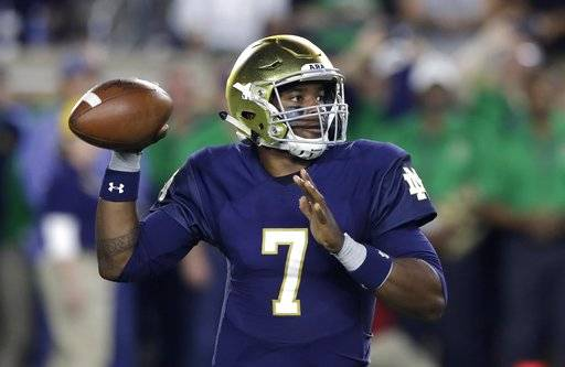 FILE - In this Oct. 21, 2017, file photo, Notre Dame quarterback Brandon Wimbush throws during the first half of an NCAA football game against Southern California in South Bend, Ind. Dual-threat quarterbacks will take center stage when No. 3 Notre Dame visits No. 7 Miami on Saturday night.