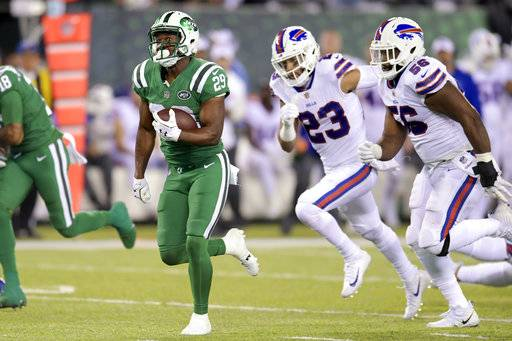 FILE - In this Nov. 2, 2017, file photo, New York Jets running back Bilal Powell, center, runs with the ball as Buffalo Bills strong safety Micah Hyde (23) and defensive end Ryan Davis (56) chase him during the second half of an NFL football game, in East Rutherford, N.J. Winning in daily fantasy isn't always about finding contrarian picks. Yes, you want to differentiate your lineup to increase your odds at winning in tournaments, but you can't ignore the studs that are still worth their high price tags.