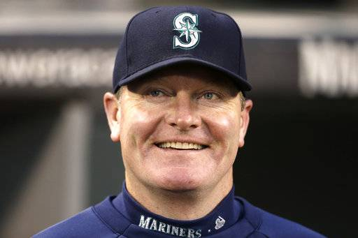 FILE - In this Sept. 25, 2013, file photo, then-Seattle Mariners manager Eric Wedge smiles before a baseball game against the Kansas City Royals, in Seattle. Former Cleveland and Seattle manager Eric Wedge has become the second person to interview with the New York Yankees for their dugout opening. He follows Yankees bench coach Rob Thomson, who interviewed Wednesday, Nov. 10, 2017. (AP Photo/Elaine Thompson, File)