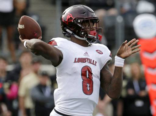 Louisville's Lamar Jackson (8) looks to pass against Wake Forest during the second half of an NCAA college football game in Winston-Salem, N.C., Saturday, Oct. 28, 2017.