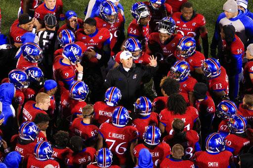 FILE - In this Nov. 19, 2016, file photo, Kansas head coach David Beaty speaks to his team before overtime of an NCAA college football game against Texas in Lawrence, Kan. The Jayhawks head to Texas this week looking for a repeat of their shocking win in 2016.