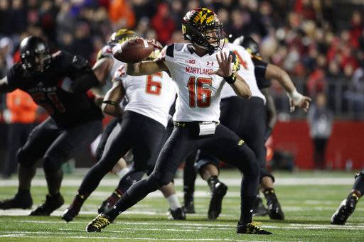 FILE - In this Nov. 4, 2017, file photo, Maryland quarterback Ryan Brand throws a pass against Rutgers during the second half of an NCAA college football game in Piscataway, N.J. Max Bortenschlager made his first start for Maryland on Sept. 30 against Minnesota and has since been knocked out of two games, including last week's loss at Rutgers. His status for this week is uncertain; if he can't go, n Brand will become the team's fourth different starter at quarterback.