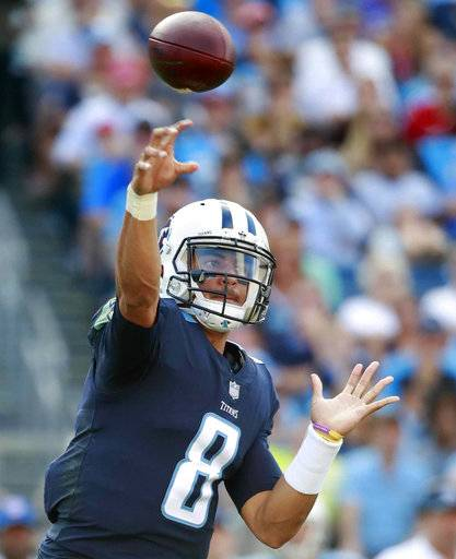 FILE - In this Nov. 5, 2017, file photo, Tennessee Titans quarterback Marcus Mariota (8) throws a pass against the Baltimore Ravens during an NFL football game, in Nashville, Tenn. The Titans take on the Bengals Sunday in Tennessee. (Jeff Haynes/File)