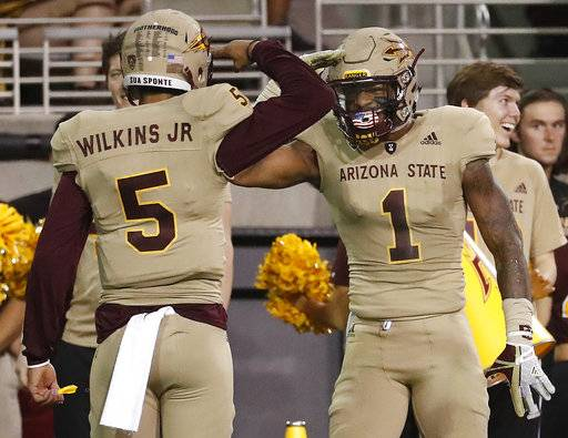 Arizona State quarterback Manny Wilkins (5) wide receiver N'Keal Harry (1) after a touchdown against Colorado during the first half of an NCAA college football game, Saturday, Nov. 4, 2017, in Tempe, Ariz.