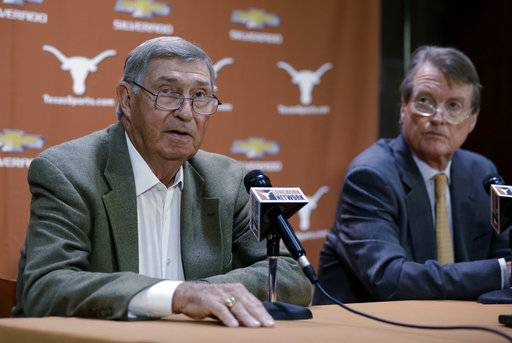 FILE - In this Oct. 1, 2013, file photo, Texas athletic director DeLoss Dodds, left, with Texas president Bill Powers, right, formally announces his retirement during a news conference, in Austin, Texas. Dodds, Powers and former football coach Mack Brown all are scheduled to be questioned under oath next week in a sex and race discrimination lawsuit filed by former women's track coach Bev Kearney, who was forced out after the school learned she had a romantic relationship with one of her athletes a decade earlier. (AP Photo/Eric Gay, File)