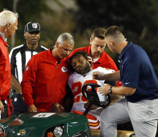 FILE - In this Sept. 7, 2017, file photo, Kansas City Chiefs safety Eric Berry (29) is consoled after he was put on a cart following an injury during the second half of an NFL football game against the New England Patriots, in Foxborough, Mass. Everyone is wondering why there have been so many injuries in 2017.
