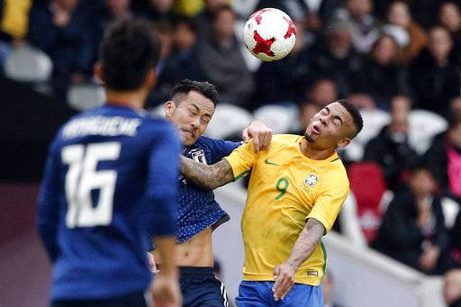 Brazil's Gabriel Jesus, right, challenges the ball with Japan's Maya Yoshida during their international friendly soccer match Brazil against Japan at the Pierre Mauroy stadium in Lille, northern France, Friday, Nov. 10, 2017.
