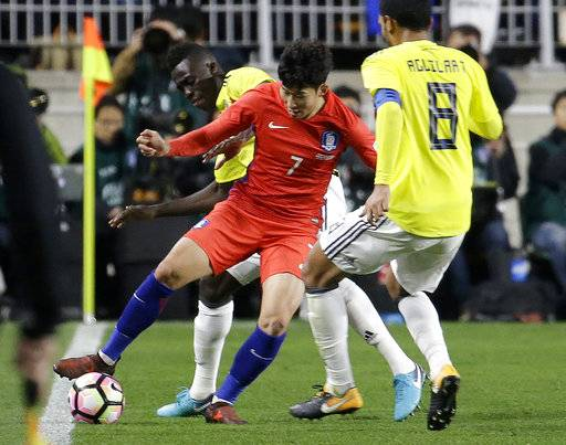 South Korea' Son Heung-min, second from right, fights for the ball against Colombia's and Davinson Sanchez and Abel Aguilar, right, during their friendly soccer match at Suwon World Cup Stadium in Suwon, South Korea, Friday, Nov. 10, 2017.