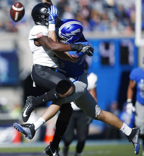 Army defensive back Gibby Gibson, left, collides with Air Force tight end Ryan Reffitt as he tries to pull in a pass in the first half of an NCAA college football game Saturday, Nov. 4, 2017, at Air Force Academy, Colo.