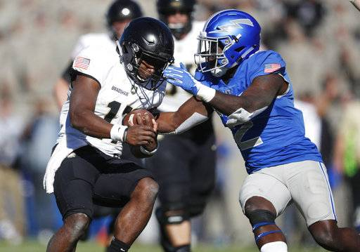 Air Force defensive back Marquis Griffin, right, tackles Army quarterback Ahmad Bradshaw after a long run in the first half of an NCAA college football game Saturday, Nov. 4, 2017, at Air Force Academy, Colo.