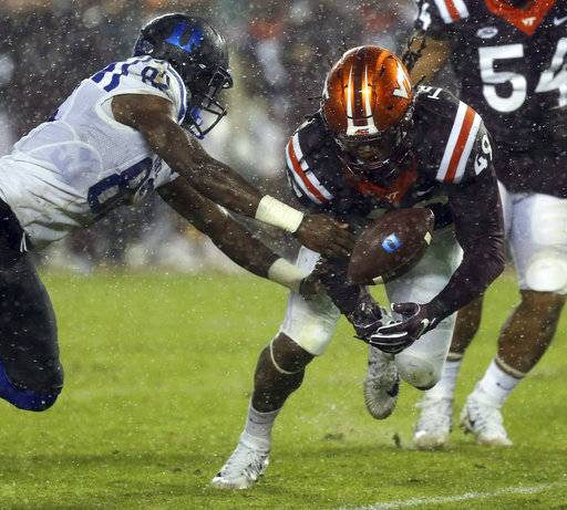Virginia Tech defender Tremaine Edmunds (49) dives for a ball tipped by Duke receiver Chris Taylor (82) in the second half of an NCAA college football game in Blacksburg Va., Saturday, Oct. 28, 2017. Virginia Tech won the game 24-3. (Matt Gentry/The Roanoke Times via AP)