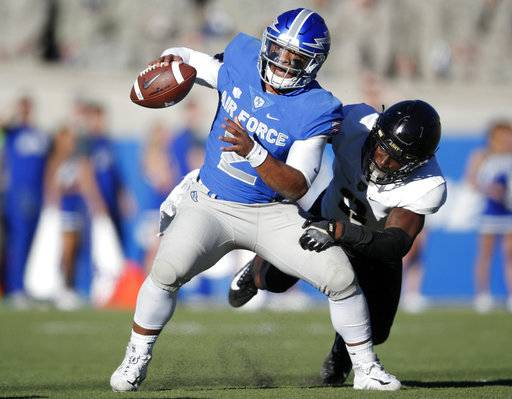 Air Force quarterback Arion Worthman, front, eludes a tackle by Army defensive back Gibby Gibson in the second half of an NCAA college football game Saturday, Nov. 4, 2017, at Air Force Academy, Colo.