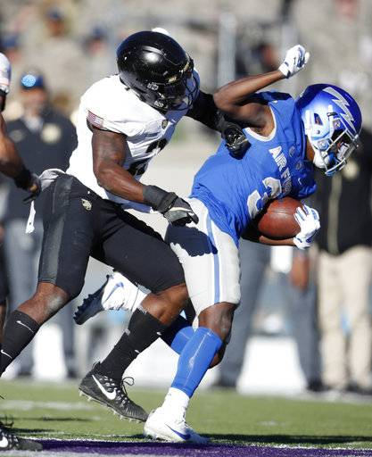 Army defensive back Gibby Gibson, left, knocks Air Force wide receiver Ronald Cleveland out of play after Cleveland fielded a pass in the second half of an NCAA college football game Saturday, Nov. 4, 2017, at Air Force Academy, Colo.