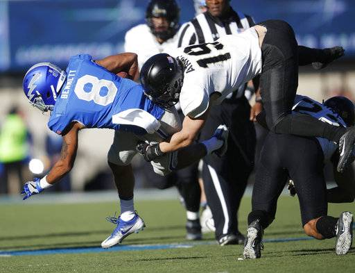 Air Force wide receiver Marcus Bennett, left, is tackled by Army linebacker James Nachtigal, center, after pulling in a pass as he flies over defensive back Elijah Riley in the second half of an NCAA college football game Saturday, Nov. 4, 2017, at Air Force Academy, Colo.