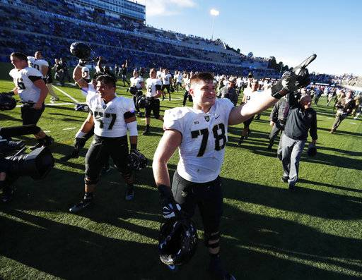 Army offensive lineman Brett Toth gestures to fans as time runs out in the second half of an NCAA college football game against Air Force, Saturday, Nov. 4, 2017, at Air Force Academy, Colo.
