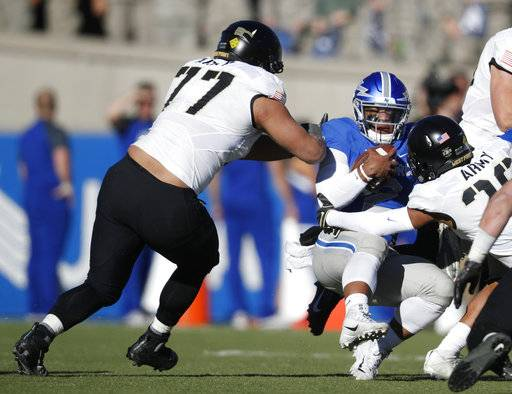 Air Force quarterback Arion Worthman, center, is stopped after a short gain by Army defensive lineman Raymond Wright, left, and defensive back Richard Hanson in the second half of an NCAA college football game Saturday, Nov. 4, 2017, at Air Force Academy, Colo.