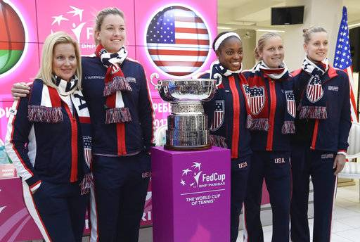 United States Fed Cup team members captain Kathy Rinaldi, CoCo Vandeweghe, Sloane Stephens, Shelby Rogers, Alison Riske, from left to right, pose for photo after drawing ceremony, in Minsk, Friday, Nov. 10, 2017. The Fed Cup final matches between Belarus and USA will take place Nov. 11 - 12, 2017. (AP Photo/Sergei Grits)