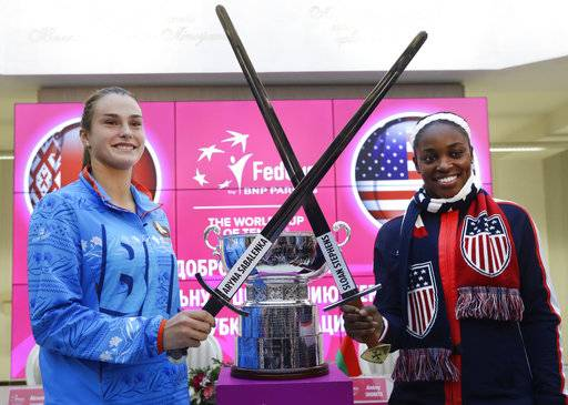 United States Fed Cup team member Sloane Stephens, right, and Belarus' team player Aryna Sabalenka pose for a photo after drawing ceremony, in Minsk, Friday, Nov. 10, 2017. The Fed Cup final matches between Belarus and USA will take place Nov. 11 - 12, 2017.