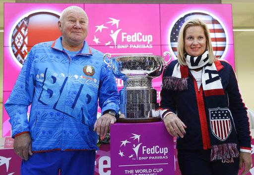 United States team captain Kathy Rinaldi, right, and Belarus' team captain Eduard Dubrou pose for photo after drawing ceremony, in Minsk, Friday, Nov. 10, 2017. The Fed Cup final matches between Belarus and USA will take place Nov. 11 - 12, 2017.